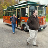 WARREN DILLAWAY / Star Beacon<br /> STATE REPRESENTATIVES David Hall (right) of Holmes County and John Patterson of Jefferson leave Jolly Trolley during an agricultural committee tour of Ashtabula County.