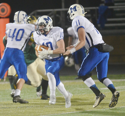 WARREN DILLAWAY / Star Beacon<br /> AUSTIN BURKHOLDER (11), Madison quarterback, hands    off to Aaron Petruccelli on Friday night at Lakeside. Petruccelli ran for a touchdown.