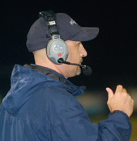 WARREN DILLAWAY / Star Beacon<br /> JOHN GLAVICKAS,  Grand Valley football coach, watches the action Friday night during a home game with Ledgemont.