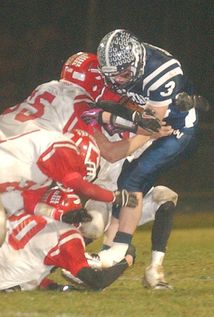 WARREN DILLAWAY / Star Beacon<br /> JAKE VORMELKER (3) of Grand Valley is surrounded by four Ledgemont tacklers Friday evening in Orwell.