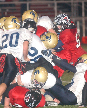WARREN DILLAWAY / Star Beacon<br /> TROY COLUCCI (28) of Conneaut is surrounded by Jefferson defenders Friday evening at Jefferson's Falcon Pride Stadium.