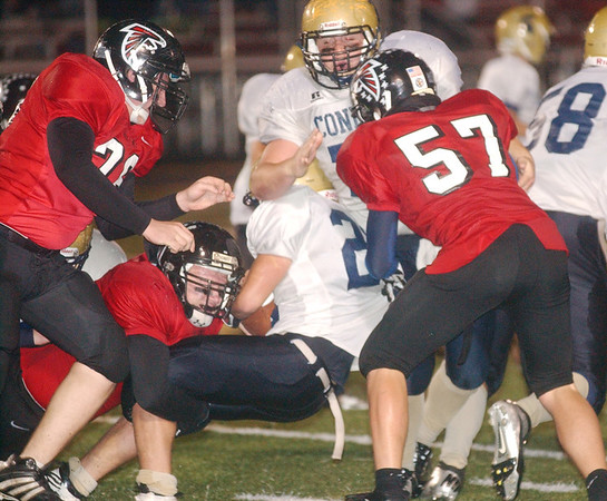 WARREN DILLAWAY / Star Beacon<br /> TROY COLUCCI (with ball) of Conneaut is surrounded by Jefferson defenders including Daniel Gillespie (67) and Troy Stitt (57).