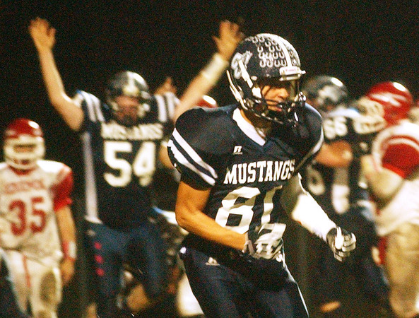WARREN DILLAWAY / STar Beacon<br /> JOSH KOVATS (81) of Grand Valley celebrates and teammate Jack Scott signals touchdown after a first half score by quarterback Kyle Orgovan Friday night in Orwell.
