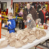 WARREN DILLAWAY / Star Beacon<br /> HEWITT WILT, 8, (far left), Jonathan Butterfield, 7, Jesse Butterfield, 4, and Dean Butterfield (behind Jonathan Butterfield) grab some refreshments during Ghoulfest on Saturday night at the Geneva Fire Department.