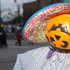 WARREN DILLAWAY / Star Beacon<br /> AN UPSIDE-DOWN pumpkin head greets visitors to downtown Geneva's Ghoulfest Saturday.