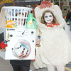 WARREN DILLAWAY / Star Beacon<br /> KARA HUTCHINSON (left) and Kenna Sanborn,  both 11 of Geneva, walked away with hardware following the Ghoulfest costume contest Saturday in Geneva. Hutchinson won the funniest costume category and Sanborn walked away with the most original.