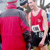 WARREN DILLAWAY / Star Beacon<br /> CHRIS LEMAY of  Edgewood was all smiles Saturday while talking with coach Steve Hill after qualifying for the Division II state cross country meet next week in Columbus.
