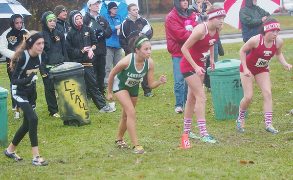 WARREN DILLAWAY / Star Beacon<br /> AREA RUNNERS (from left) Katie Divisin of Riverside, Karen Barrientos of Lakeside, Hailey VanHoy and Emily Deering, both of Geneva, wait for the gun Saturday prior to the Division I regional cross country meet at Boardman.