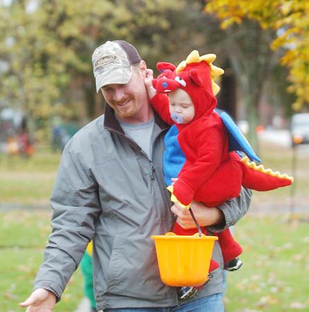 WARREN DILLAWAY / Star Beacon<br /> JARED SACH carries his son Landen Sach, 15 months, during trick or treat fun on West Erie Street in Jefferson Saturday afternoon.
