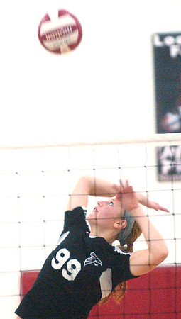WARREN DILLAWAY / Star Beacon<br /> HAYLEY ALLEN of Jefferson leaps for a spike Tuesday during a home match with Girard.