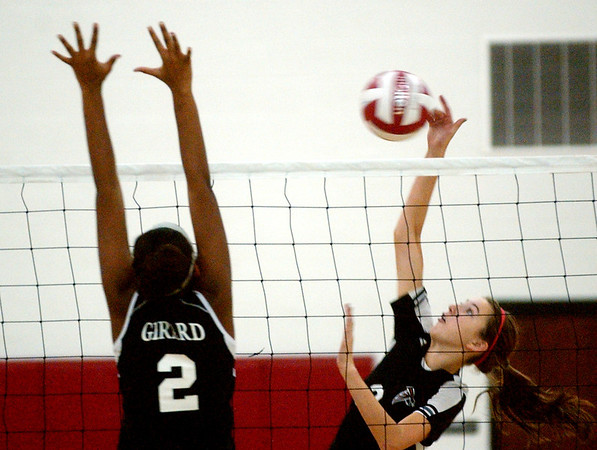 WARREN DILLAWAY / Star Beacon<br /> BAILEY BECKWITH (right) of Jefferson leaps for a spike as Griard's Shymara Dykes leaps for a block Tuesday night at  Jefferson.