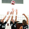 WARREN DILLAWAY / Star Beacon<br /> BAILEY BECKWITH (2) and Jefferson teammate Hayley Allen leap for a block of a spike by Girard's Justine Palmer Tuesday night at Jefferson.