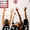 WARREN DILLAWAY / Star Beacon<br /> HAYLEY ALLEN (99) of Jefferson leaps for a spike as Girard's Justine Palmer and Shymara Dykes (2) leap for a block Tuesday night at Jefferson.