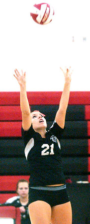 WARREN DILLAWAY / Star Beacon<br /> TAYLER JOHNSTON of Jefferson sets the ball Tuesday during a home match with Girard.