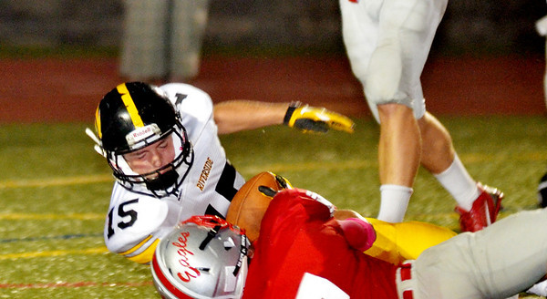 WARREN DILLAWAY / Star Beacon<br /> PAT REMINGTON of Riverside tumbles into the end zone for a touchdown with Travis Blake of Geneva on Friday night against Geneva at Spire Institute in Harpersfield Township.