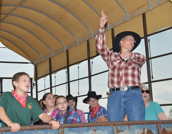 WARREN DILLAWAY / Star Beacon<br /> BOB FRALIC (right with hat) gets the troops fired up before a hay ride at the South Ridge Christian Academy Fall Harvest Festival in Conneaut on Friday. The event continues today from 11 a.m. to 9 p.m. today.