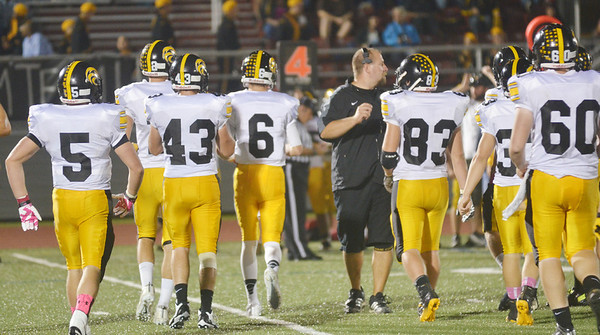 WARREN DILLAWAY / Star Beacon<br /> DAVE BORS, Riverside head football coach, gathers his team during a time Friday night during a game with Geneva at Spire Institute in Harpersfield Township.