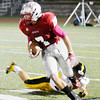 WARREN DILLAWAY / Star Beacon<br /> TRAVIS BLAKE (7) of Geneva tries to elude a Riverside tackler on Friday night at Spire Institute in Harpersfield Township.