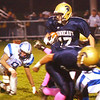 WARREN DILLAWAY / Star Beacon<br /> ASHLAN SHEARER (27) of Conneaut tries to find running room Friday night during a home game with Gilmour Academy.