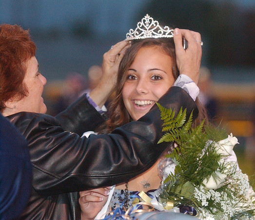 WARREN DILLAWAY / Star Beacon<br /> ALYSSA ANDES, Conneaut Homecoming Queen, has her crown readjusted by her motherPamela Andes Friday night prior to the Gilmour Academy football game.