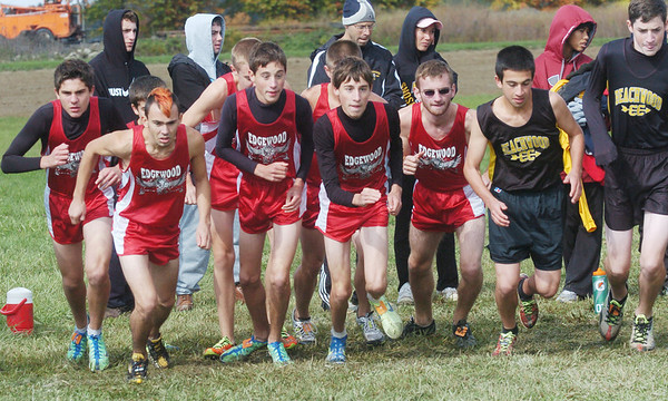 WARREN DILLAWAY / Star Beacon<br /> EDGEWOOD BOYS cross country team breaks from the line with Beachwood during the Division II Legends Meet at the Trumbull County Fairgrounds Saturday.