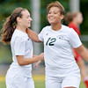 WARREN DILLAWAY / Star Beacon<br /> ADRIAN COLTER (12) of Lakeside congratulates teammate Kaytee Candella after Candela scored a goal during a home match with Edgewood on Monday afternoon.