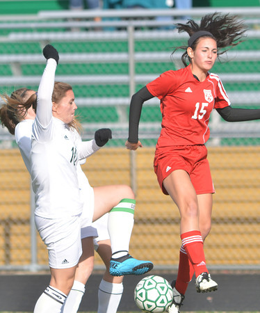 WARREN DILLAWAY / Star Beacon<br /> ZOEY CAMPBELL (left front) of Lakside and Sarah Stell of Edgewood (15) battle for the ball on Monday during a soccer match at Lakeside.