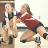 WARREN DILLAWAY / Star Beacon<br /> EMILY DEGEORGE (left) and Jefferson teammate Brook Wilks collide on Tuesday during a home match with Liberty.