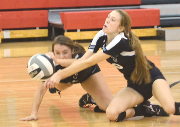 WARREN DILLAWAY / Star Beacon<br /> TAYLER JOHNSTON (left) and Emily DeGeorge, both of Jefferson, dive for the ball on Tuesday night during a home match with Liberty.