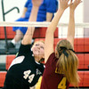 WARREN DILLAWAY / Star Beacon<br /> HAYLEY ALLEN (44) of Jefferson reaches for the spike as Allie Adler leaps for the block on Tuesday at Jefferson.