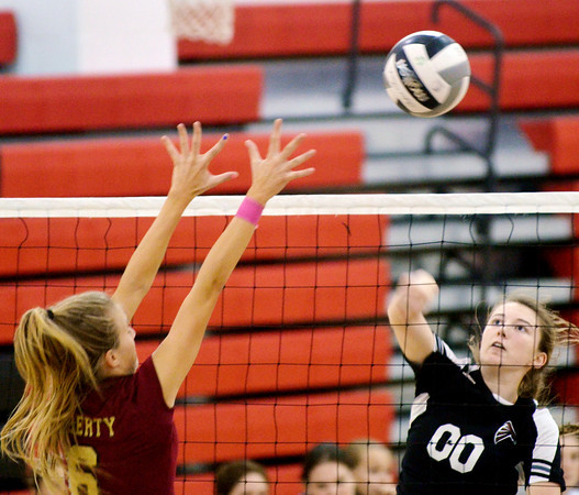WARREN DILLAWAY / Star Beacon<br /> BAILEY BECKWITH (00) of Jefferson tries to  spike the ball by Courteney Lukac on Tuesday evening at Jefferson.