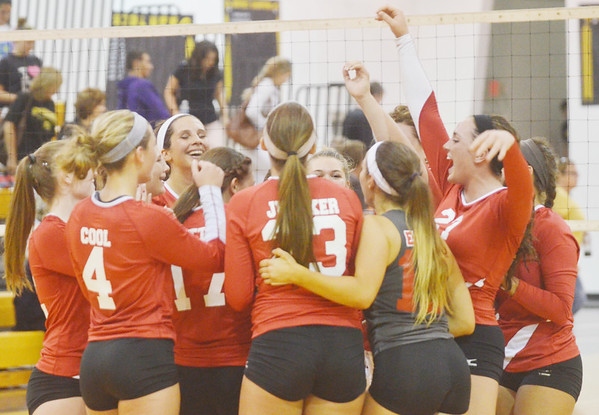 WARREN DILLAWAY / Star Beacon<br /> THE GENEVA volleyball team celebrates after defeating Riverside on Thursday at Riverside.