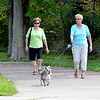 WARREN DILLAWAY / Star Beacon<br /> NANCY GRAY (right) and her dog walk with friend Jean McDowell, both of Aurora on Thursday at Geneva State Park.