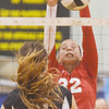 WARREN DILLAWAY / Star Beacon<br /> EMILY BALL (32) of Geneva  leaps to block a psike by Ashley Plassard (21) of Riverside on Thursday at Riverside.