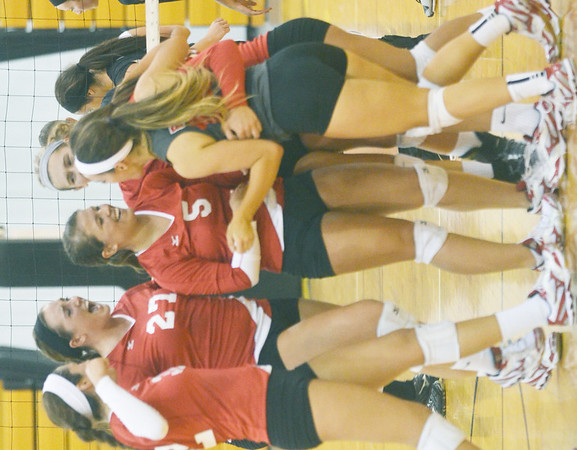 WARREN DILLAWAY / Star Beacon<br /> MEMBERS OF the Geneva volleyball team celebrate after winning a point on Thursday night during a match on  at Riverside. Emily Ball (far left), Chelsea Scafuro (27), Kylee Corlew (5) and Christa Cash (15) (gray uniform) went on to beat Riverside in three games.