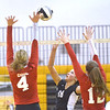 WARREN DILLAWAY / Star Beacon<br /> RACHEL STROSKI (18) of Riverside  tries to get the ball by Megan Cool (4) aand Cari Getz (12), both of Geneva, on Thursday at Riverside.
