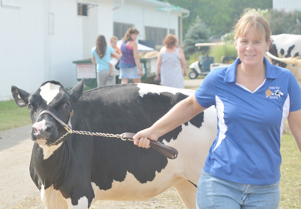 WARREN DILLAWAY / Star Beacon<br /> MEGHAN TURON of West Farmington  leads a cow to water on Saturday at the Great Geauga County Fair in Burton.