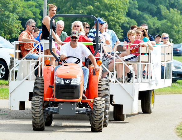 WARREN DILLAWAY / Star Beacon<br /> VISITORS TO The Great Geauga County Fair get a ride from the parking lot to the gate on Saturday morning in Burton Township.