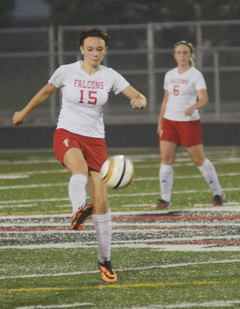 WARREN DILLAWAY / Star Beacon<br /> WHILLA LESLIE (15) of Jefferson kicks the ball with teammate Leah Molenda in the background on Monday at Jefferson during a match with Newton Falls.