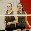 WARREN DILLAWAY / Star Beacon<br /> CARI GETZ (12) and Geneva teammate Kylee Corlew wait for a serve on Monday night during a home match with Conneaut.