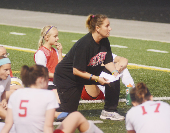 WARREN DILLAWAY / Star Beacon<br /> KATIE CARTER, Jefferson soccer coach, talks to her team during halftime of a home game on Monday evening against Newton Falls.