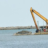 WARREN DILLAWAY / Star Beacon<br /> A LARGE barge is used to dredge the Ashtabula Harbor on Mondayafternoon.