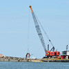 WARREN DILLAWAY / Star Beacon<br /> A LARGE barge is used to dredge the western channel of Conneaut Harbor on Monday morning.