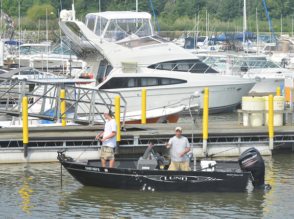 WARREN DILLAWAY / Star BeacON<br /> FISHERMEN TRY their luck in Geneva State Park Marina Harbor on Monday morning.