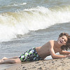 WARREN DILLAWAY / Star Beacon<br /> BOBBY JOHNSTON, 14, of Pittsburgh hams it up after jumping a big wave at Geneva State Park on Monday.