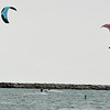 WARREN DILLAWAY / Star Beacon<br /> WIND SURFERS navigate Conneaut Harbor on Monday.