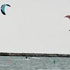 WARREN DILLAWAY / Star Beacon<br /> WIND SURFERS navigate Conneaut Harbor on Monday.