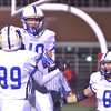 WARREN DILLAWAY / Star Beacon<br /> JACK HOLL of Madison celebrates with Blue Streak teammates Thomas Purkey (89) nd Ben Bruening (8) after scoring a touchdown on Friday night at Perry.