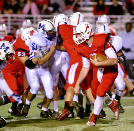 WARREN DILLAWAY / Star Beacon<br /> RYAN KAHOUN, Perry quarterback, tries to find running room on  Friday night during a home game with Madison.