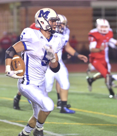 WARREN DILLAWAY / Star Beacon<br /> BRANDON DAVIS, Madison running back, tries to find running room on Friday night at Perry.